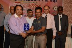 Mr. Javed Ahmed Chairman KCCA Zone II giving Shield to Rao Javed