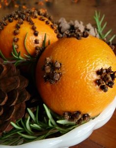 These remind me of my grandmother.  She always decorated with oranges at Christmas to remind her that when she was small, oranges WERE the gifts they found in their stockings....cloves in oranges #food #recipe  Smell great for years!