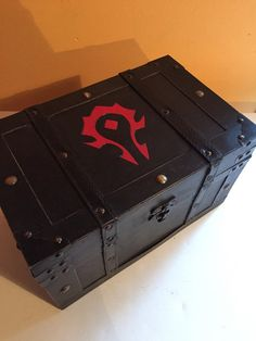 Listed is a Horde inspired wooden chest decorated with dark leather and dark stain, and hand wood burned with the Horde insignia. A great decoration