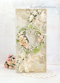 Gorgeous wedding card with hearts and flowers. So beautiful it could be framed and made into a wedding day keepsake.