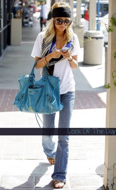 The bag is far too big but the jeans give her a long line - would be better with wedge heels hidden underneath