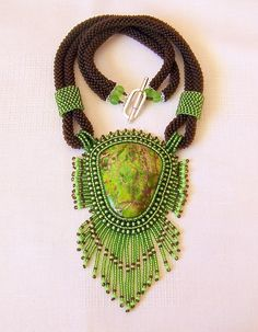 Bead Embroidery Necklace - Green Earth After long and happy hours of creative work this necklace was born . Beautiful Green Sea Sediment Jasper stone (45x40mm), czech seed beads, glass beads, beaded crocheted rope using czech seed beads. The back of the necklace is finished with leather for