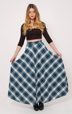 This 60s plaid skirt is timeless! Classic A line shape with a long flared maxi length. It has a thin fitted waistband and a button and zipper closure. Made of a lightweight cotton in shades of blue, white and green. So versatile…dress it up or down!  Measurements Size: Tag size 14 (juniors) Waist: 26 Hips: Full Length: 41  Details Circa: 1960s Color: Blue, white, green Material: Cotton No Label Condition: Great condition  Be our Friend... Facebook.com/LotusVintage Instagram.com/LotusVintage…