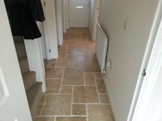 The Rustic Travertine is a warm golden colour, with a very rustic chipped edge. It looks even more rustic in the opus pattern, as laid in our customer's hallway.