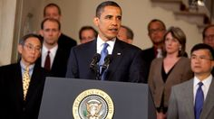"""🇺🇸 Barack Obama delivers his """"The End of an Old GM, and the Beginning of a New GM"""" speech on June 1, 2009 in the Grand Foyer of the White House. Secretary of Energy Steven Chu is to Obama's right and Secretary of Veterans Affairs Eric Shinseki is to Obama's left.  Photo by Samantha Appleton, White House photographer"""