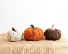 Cute and cozy hand-knit pumpkins.