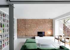 Espace St-Denis by Anne Sophie Goneau // Exposed Brick + Bottle Green