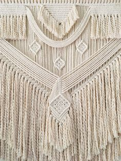 This Macrame Wall Hanging was designed and made with love, it has a wonderful flow and calmness to it. It is a large piece made from 5mm diameter natural cotton rope and a dow rod. It is approximately 100cm (39.5) wide, 130cm (57) long with the attached loop, from rod to bottom of tassels
