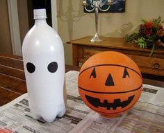 ghost bowling.  This would be cute for a school fall festival or Halloween party. I could put glow sticks in the 2 liter bottles.  Cute idea! (label the  pins with numbers 1-10. Then have kids find the sum of the pins they knocked down to get their score.)