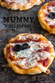 Mummy Mini Pizzas at http://therecipecritic.com  Delicious and easy mummy pizzas that are perfect for Halloween.  #halloween #pillsbury