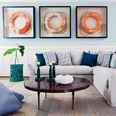 Vintage life rings give this coastal living room a unique and eclectic vibe. Featured on Completely Coastal.