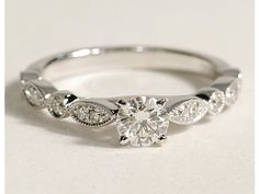 Normally I am all for simplistic no extra bling on a ring but I would make an exception for this ring the winding band is so pretty