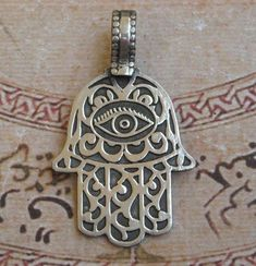 Hamsa necklace pendant. Most people, especially in the Islamic world,  associate this symbol as the hand of Fatima, daughter of the Prophet Muhammad. However, some Christian groups connote it with the hand of Mary, mother of Jesus,  while some Jewish groups view it as the hand of Miriam, sister of Moses.