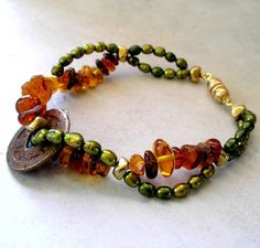 Ancient Coin Bracelet with Pearls and Baltic Amber by Foret, $75.00