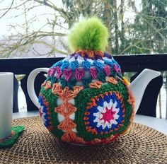 Started with four granny squares and four buttons then freestyled it on the teapot. #crochetdaydream