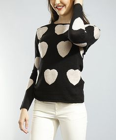 Young, fun and oh-so chic, this trend-savvy sweater is a fashion-forward breath of fresh air. Boasting a haute heart pattern and a sumptuously soft construction, this pretty piece is sure to inspire a series of stylish ensembles.100% acrylicHand washImported