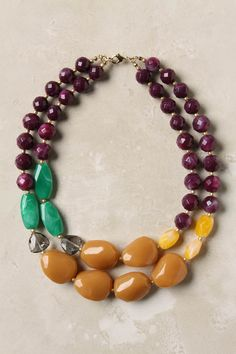 from Anthropologie. Idea for multi strand, multi-colored necklace.