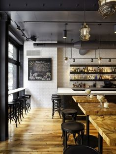 Like the mix of tones (wood floor, black trim and stools, white tiles) and the floating shelves.