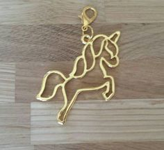 This charm is made up of a metal, gold coloured unicorn and is the perfect way to personalise your belongings. This charm would be a perfect decoration for your planner, bag or jacket. The unicorn measures approximately and comes with a lobster clasp. Unicorn Gifts, Stocking Fillers, Lobster Clasp, Charmed, Gift Ideas, Jacket, Decoration, Metal, Unique Jewelry