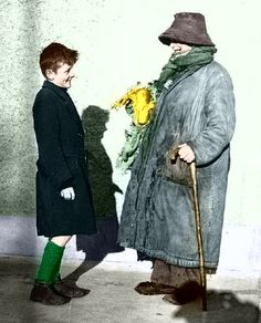 """""""Forty Coats, how many coats ye wearin' today?"""" - Forty Coats chatting to a young lad in Dublin, February, 1943 (Independent Newspapers) Colourised by Pearse Ireland Pictures, Old Pictures, Old Photos, Irish People, Young Lad, Photo Engraving, Dublin City, Interesting Faces, The Past"""