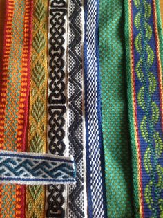 Inkle weaving samples 2nd from left and the one on the far right. Coolness!