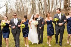 navy bridesmaid dresses grey groomsmen suits but with blue ties!