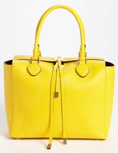 Michael Kors Miranda Tote -> i usually have a certain level of aversion towards michael korrs, albeit my sister's work involve promoting it. However, this miranda has a striking colour. The box style does making it a tote a little odd though. Nonetheless, this is okay on my books