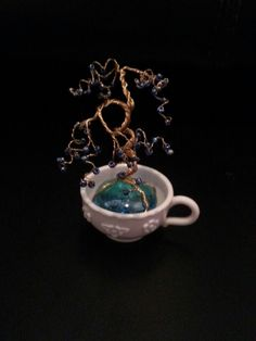 Tea cup tree with dark blue beads