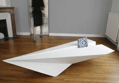Paper Plane Coffee Table by Lorraine Brennan | DigsDigs Made of 2mm folded powder coated mild steel with optional silicone inset