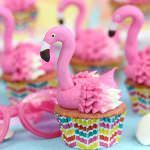 Flamingo Cupcakes - pink lemonade cupcakes decorated to look like pink flamingos! Perfect for summer! | From SugarHero.com