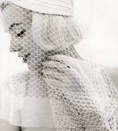 Great texture of the veil to add interest ... love the profile pose and composition ...