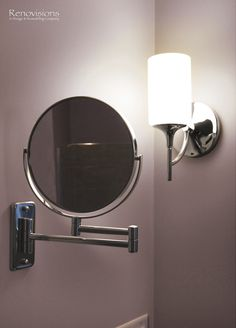 Bathroom remodel by Renovisions. Contemporary style, pull out magnifying mirror, chrome fixtures