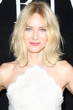 We love how the actress' hair is doing that flipped-out '50s housewife thing in a subtler, more modern way.   - HarpersBAZAAR.com