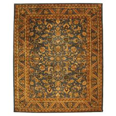 Hand-tufted wool rug with a botanical Persian-inspired motif.  Product: RugConstruction Material: 100% Wool...