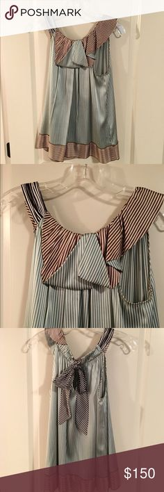 """BCBG Multi-Color Stripped Silk Blouse BCBG Multi-Color Stripped Silk Blouse. A gathered halter neckline instantly elevates this top. Folding detail at the neck with contrast colors. Trim of blouse has contrast strips as well. The bottom of the blouse flairs out so that this blouse has a very light and breezy look & feel. Tie neck  & key hole in back. Previously owned without any signs of wear. Approx 25"""" long. BCBGMaxAzria Tops Blouses"""