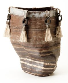 // You can enjoy life in a way most people don't. Want to find out how ? Contact me and let's talk : www.beyondletting-go.com Brenda Holzke~ stoneware vessel with porcelain inlays and added tassels.