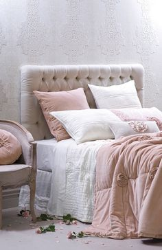 A timeless ivory 100% cotton bedspread with a gorgeous pink velvet comforter that is puffy, inviting and luxurious.