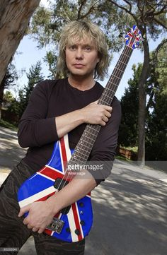 Def Leppard's bassist Rick Savage. Love that Bass....