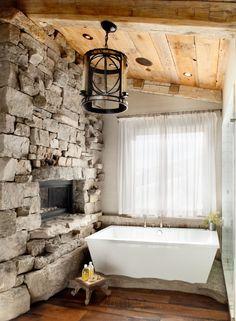 rustic bathroom w/ rock fireplace