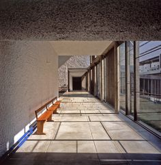 Corridor to atrium cadenced with sunshine in late morning. Monastery of Sainte Marie de la Tourette, Éveux-sur-l'Arbresle, France. Image © Henry Plummer 2011