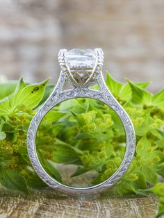 The Rayna is a special vintage-inspired diamond solitaire engagement ring with intricate hand-engraving for a subtle yet stunning look. Shown here with a cushion cut diamond.