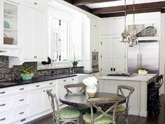 Cool contemporary kitchen with natural finishes. Like the white/dark contrast and the beams are to die for.