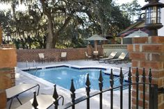 go for a dip under Spanish moss draped oak trees at The Inlet Sports Lodge, located in the Coastal South Carolina town of Murrells Inlet