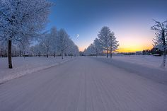 moon and sunrise on beautiful snowy road