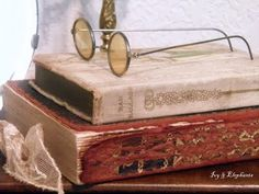 vintage book display with wire frame glasses