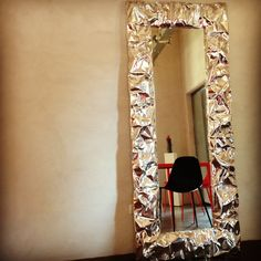 Hand wrinkled aluminium for an unusual mirror, #TabUmirror by #OpinionCiatti produces reflection plays to catch only the best images.