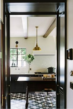 subway tiles all the way up // black cabinets // tile