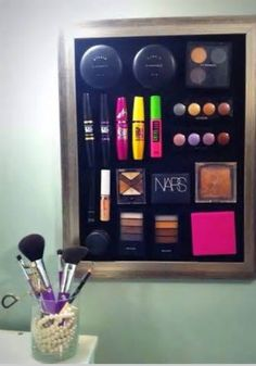 Put magnets on the back of your makeup products and then hook them to a magnetic board!
