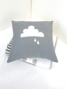embroidered rain cloud pillow