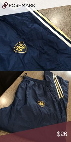 Adidas track pant Elastic waist, drawstring, zipper at ankles. Lined. Notre Dame logo and colors in navy pants adidas Pants Sweatpants & Joggers